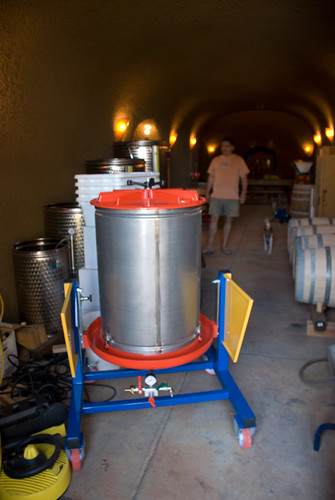 After our grapes ferment with the skins in the white vats above, theyll be squeezed through the new bladder press.