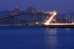 Richmond - San Rafael Bridge (A Sutanto) Tags: california ca longexposure bridge blue usa reflection night america evening bay twilight traffic dusk commute sanfranciscobay lighttrails bluehour sanrafael sfbay richmondbridge sanrafaelbridge abigfave betterthangood vosplusbellesphotos