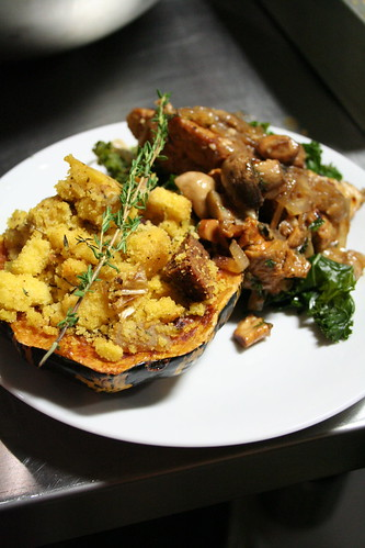 cornbread stuffing in squash, tempeh, greens, yum.
