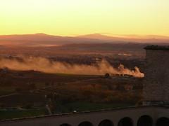 Smoke on the...valley and fire in the sky (Odisseo83) Tags: sunset italy nikon italia tramonto smoke valley perugia assisi umbria fumo vallata coolpixl3 abigfave odisseo83 andreadambrosio