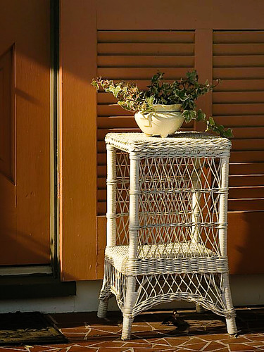 wicker table on the porch