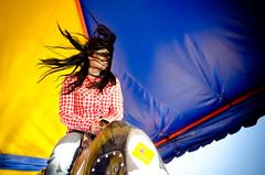 Rodeo (Dianonina) Tags: portrait azul sonora 35mm hair mexico ride retrato windy naturallight viento amarillo donne brenda cowgirl 18 hermosillo cabello ragazza capelli vaquera ventoso womanportrait expogan primario toromecanico nikond7000