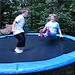 Thomas helps Cathy master the trampoline..