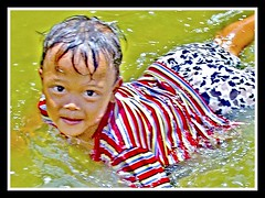 Flood: A child's happiness (maestro1020) Tags: poverty swim child flood bulacan bata baha hagonoy kahirapan langoysabaha