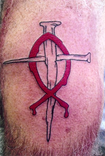 nail cross with fish tattoo