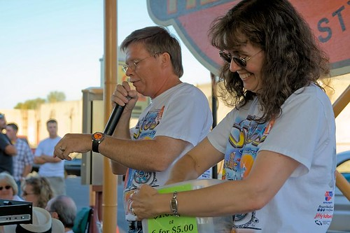 Rafflers - Russ Strohmeyer and a helper raffle tickets at the Stro's Wednesday Nite Cruise-In in Stayton Oregon
