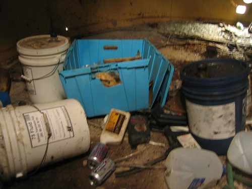 Discarded chemical drums in the tower
