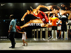 Just Do It (Life in AsiaNZ) Tags: china street man sports girl advertising poster child running nike athletes olympics slogan hurdles justdoit nanning guangxi liuxiang 110m cahinese flickrgiants