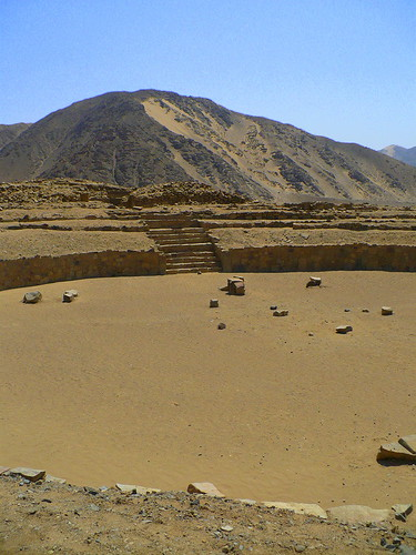 Ancient meeting circle, surrounded by towering pyramids