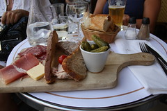 eating under the threat... (cathou_cathare) Tags: food paris france coffee caf bread pain terrace terrasse sausage ham butter baguette pickle nourriture planche saucisson jambon charcuterie beurre apro apritif vavin cornichon planchette frenchfoods pt rillettes planchedecharcuterie