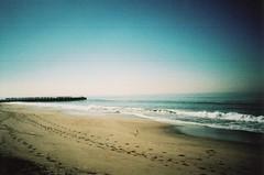 Lovely Path (R.A.Jimnez) Tags: ocean blue sky brown green water 35mm crossprocessed sand surf bright tide sunny breeze olympusxa2 walgreens cloads fujicolorsensia400isoslidefilm