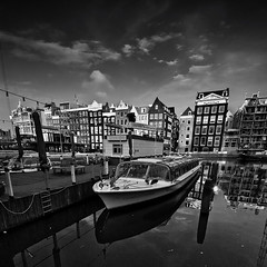 Dutch Neighbourhood (Ageel) Tags: street trip travel sea sky bw cloud white seascape black holland building art tourism water netherlands lines amsterdam clouds port d50 square lens photography boat nikon europe squares euro parking fineart cost sigma wideangle explore 1020mm sq bnw squared sigma1020mm  dutchland explored  ageel   bwsquare