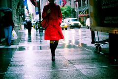 red raincoat (-{ thus }-) Tags: street city nyc red woman newyork color rain fashion digital umbrella nikon colorful f14 candid sigma nikkor raincoat passersby 30mm d40x thusihaveseen