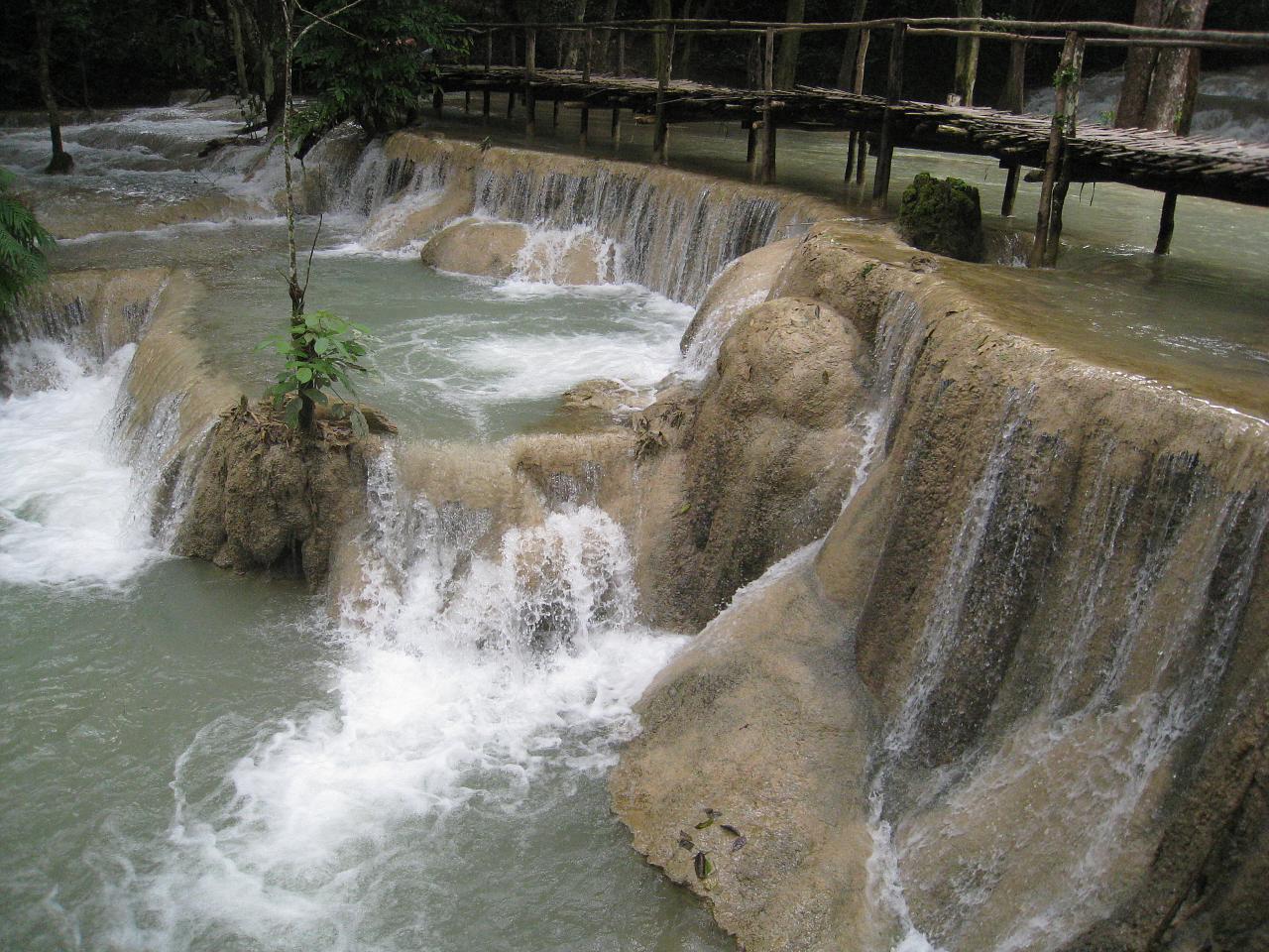 A rickety bridge across the falls