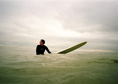Patience. (DJ Bass) Tags: sea cold water waiting coastal surfers ghostly filmgrain waterproofcamera  flatlight femalesurfers