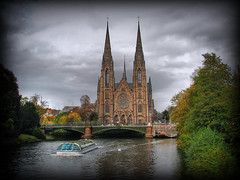 Saint Paul Church, Strasbourg (Mike G. K.) Tags: bridge trees sky france church clouds river boat swan cloudy foliage strasbourg ill alsace saintpaul hdr bateaumouche photomatix tonemapped 1exp anawesomeshot singlejpghdr excursionboat theperfectphotographer rubyphotographer damniwishidtakenthat mikegk:gettyimages=submitted