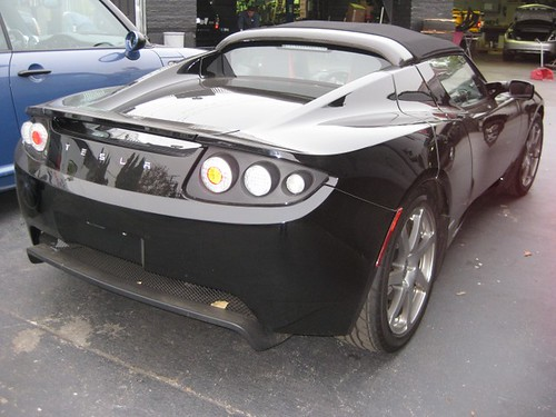 Will I Am in His Tesla Motors Roadster