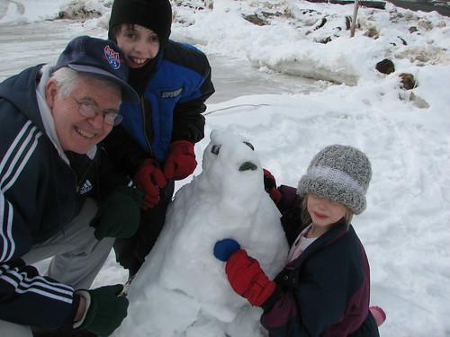 building a snowman in Ballard Park