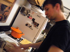 preparing the main course (christine...elizabeth...) Tags: ryan dinnerparty actionshot deliciousfood