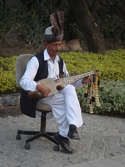 playing for your pleasure (tango 48) Tags: travel pakistan musician player entertainment islamabad sarood