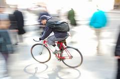 Chicago bike messenger (jeremyhughes) Tags: street shadow chicago motion blur bicycle speed movement nikon cyclist explore riding pedestrians singlespeed fixie fixedgear messenger nikkor courier panning rider bikemessenger d40 jeremyhughes 18200mmf3556gvr nikond40
