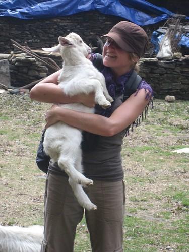 Gela hugs a goat