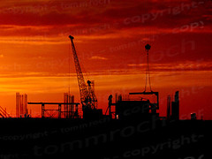 construction (tommroch) Tags: blue sunset shadow red sky orange sun building tower industry silhouette yellow architecture sunrise photography office site high workers construction scaffolding workmen flat crane steel stock working engineering cranes business growth architect creation micro housing scaffold worker copyspace build economy engineer girders girder builder expansion hoist scaffolder microstock workwomen