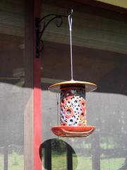 colorful ceramic birdfeeder