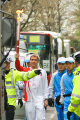 Leon Taylor carrying the Olympic Torch, Canary Wharf, 6th April 2008 (Paul Brock Photography) Tags: road london sport unitedkingdom police torch docklands daytime celebs olympics beijing2008 canarywharf torchrelay occupations olympictorchrelay torchbearer leontaylor archant