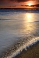 Sea Foam (Nick Carver Photography) Tags: ocean california ca sunset sea sky usa cloud sun beach nature water vertical clouds landscape outdoors coast landscapes us sand surf pacific cloudy nick stock carver orangecounty tides lagunabeach nickcarver