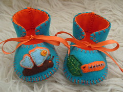 teal and orange handmade baby booties with wonderful apliquees of a caterpillar transforming into a butterfly (Funky Shapes) Tags: uk orange baby cute love animals kids butterfly children shower shoes colours handmade teal unique oneofakind mary insects felt zapatos caterpillar kawaii bebe ribbon etsy slippers booties dsm wholesale janes motifs funkyshapes apliquee