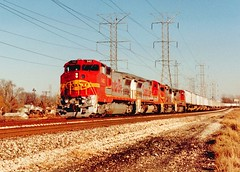 Westbound Atchinson, Topeka & Santa Fe intermodal train. Forest View Illinois. December 1990.