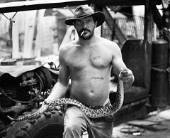 Mark the Snake Handler! (The Digital Mirage) Tags: walter portrait blackandwhite bw white man black hat digital handle person photography dangerous junk florida snake mark cigarette smoke arnold north explore mirage fl junkyard scrapyard poison cowboyhat scrap rattlesnake rattle rattler the northflorida southerner snakehandler walterarnold walterarnoldphotography2008 wwwthedigitalmiragecom hairlippeddog thedigitalmiragecom
