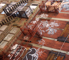 Fire escapes (Badison) Tags: street wood blue windows red urban orange brown white black brick glass metal graffiti paint afternoon random weekend guesswherenyc lookup fireescape guessed dslr graphiti stroll urbanite nikond80 urboto guessedcorrectlybyvitofun checkingoutgadgetsinchinatown