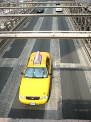 Yellow Taxi over Brooklyn Bridge