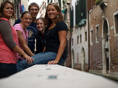 Erica Yoder, Michelle Lehman, Steven Rittenhouse, Sarah Harder, and Sarah Gant sit by a canal in Venice.