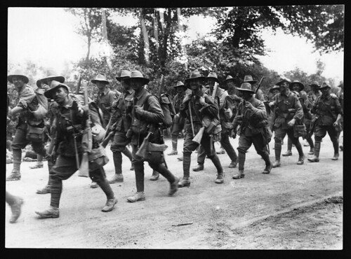 Australian troops marching along a road, France, during World War I by