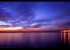 Magical Evening (Falcon EyE) Tags: longexposure nightphotography sunset red summer sky cloud abstract reflection art 30 night dark landscape harbor boat fishing fisherman nikon perfect colorful sailing photographer spectrum outdoor dramatic quay ciel citylights syria float 2008 hdr  syrien syrie aclass lattakia  18135  lowlightphotography seasunset d80 nikond80 seasunclouds darknightphotography waseemasmar seaacape   photosfromsyria photosfromlattakia  fotodilattakia
