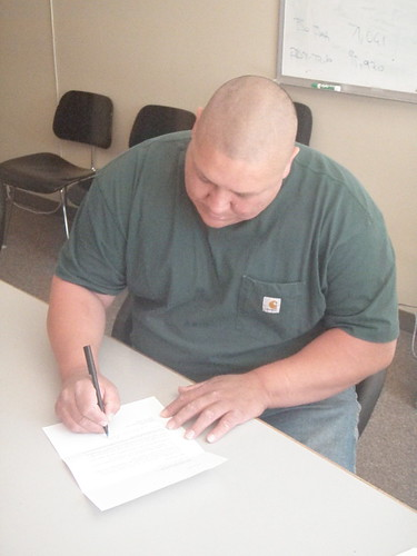 Chauncey Peltier signing letter to parole board