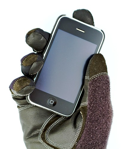 iPhone in Gloved Hand