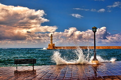 Chania, old harbor (Theophilos) Tags: sea sky lighthouse clouds bench wave crete splash chania