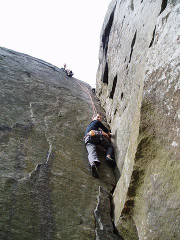 Phil climbing Green Gut at Froggatt Edge