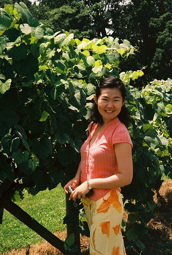 Sha with grapes at the Shenandoah Winery