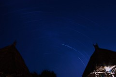 Star trails by huts