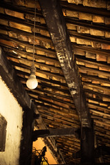 Hanging in there (Huey Yoong) Tags: old roof heritage lightbulb vintage tile asian malaysia historical melacca beams oldhouses cultural 5photosaday nikkor18200mmvr flickrestrellas