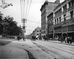 Barrington Street, Halifax, NS, about 1915 (Muse McCord Museum) Tags: street urban canada nova architecture novascotia tracks tram sidewalk powerlines transportation shops pedestrians scotia halifax stores 1915 streetscape pav brickroad shoppes mccordmuseum barringtonstreet climo musemccord ruebarrington commons:event=commonground2009