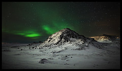 The lonely mountain (LalliSig) Tags: winter red sky orange cloud white mountain snow cold green ice rock night clouds stars landscape iceland rocks nightscape hill aurora borealis