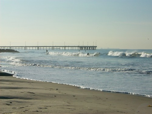 Venice pier and surfers