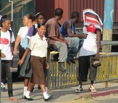 Smile for the Road (NigelDurrant) Tags: road street camera school girls men smile smiling walking women uniform crossing walk belize pedestrian uniforms belizecity centralamerica