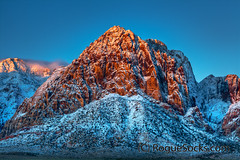 Red-Rock-Canyon-Snow-Mountains-Sunrise-Nevada-2009-008.jpg (RogueSocks) Tags: pink orange usa cloud mountain snow color weather rock sunrise sandstone glow desert lasvegas nevada conservation canyon formation geology navajo redrock hdr timeofday nevadausa